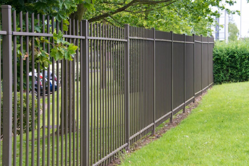 A very simple wrought iron fence without any intricate designs, still has a classic look.