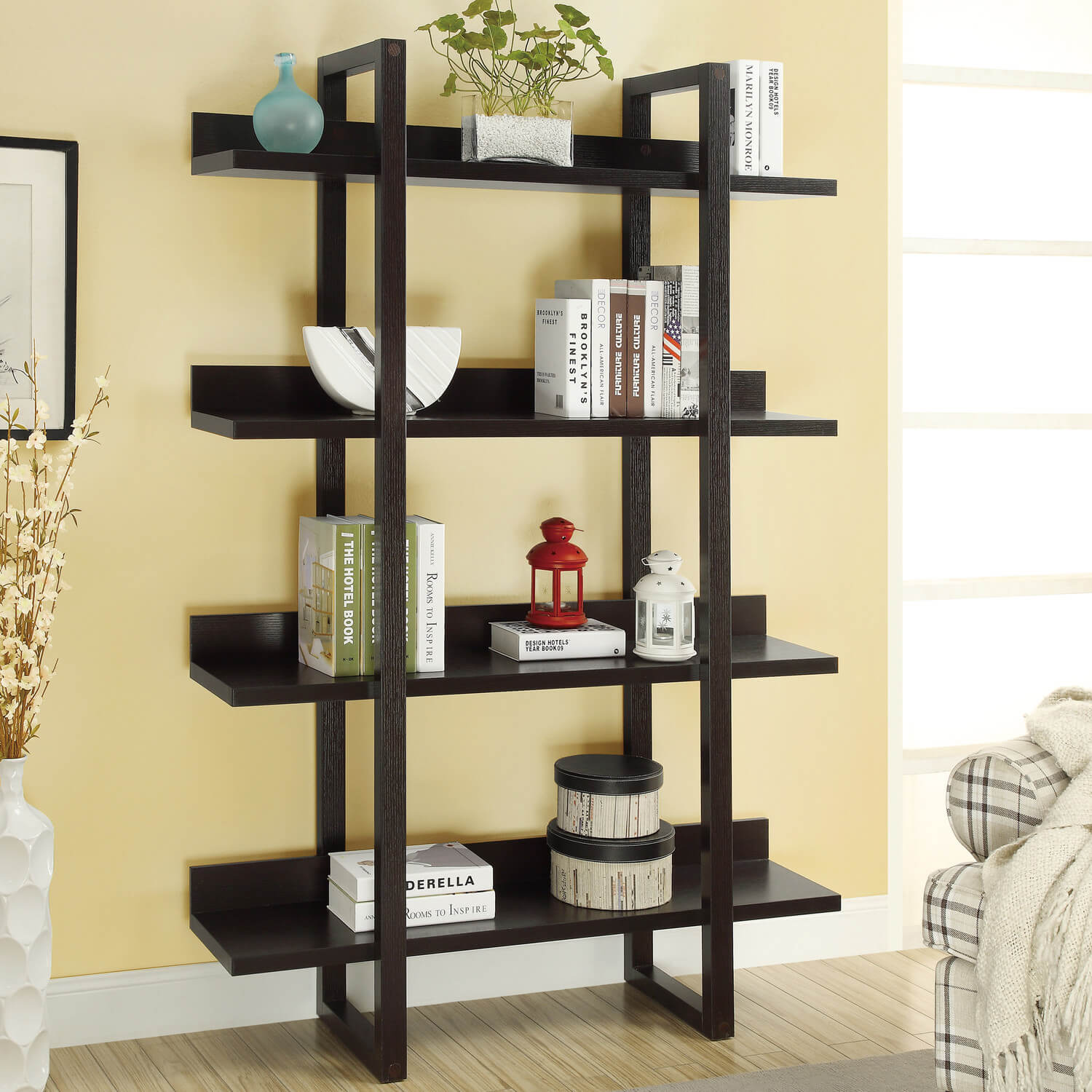 This free standing bookshelf is sleek and simple, and can fit in almost any living space. This is a nice pre-constructed, mobile, and clean bookshelf.