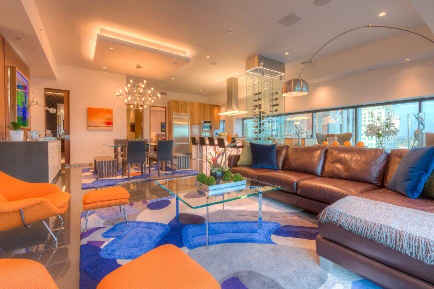 This fun and vibrant room uses blue and orange to play off of each other to make an energetic and joyous space. Blue and orange are complimentary colors, and complimentary colors are always good together.