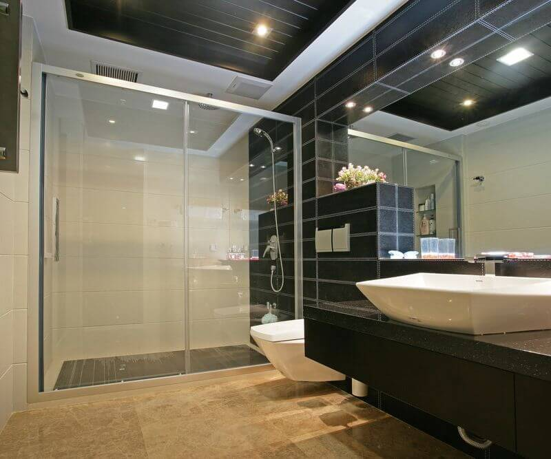 This product is a unique film that can be applied to any new or existing smooth glass surface, allowing you to easily control opacity with the click of a button or a tap on your smartphone. When it's off, the window will be frosted and opaque. When it's on, it returns to fully transparent. Here's a look at a shower door with the Smart Tint turned transparent. Looks like normal class, with full visibility. The film can be purchased in self-adhesive or non-adhesive versions, allowing for your choice of installation.