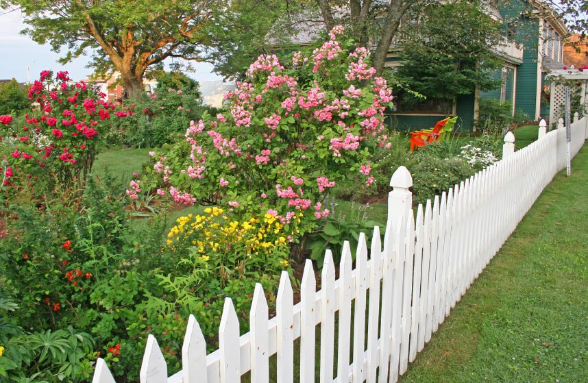 A white picket fence is a classic and iconic choice for residential areas.