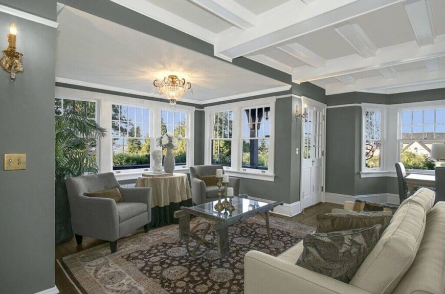 These club chairs match the walls and tuck well into this pace below the line of windows. These chairs are a great and comfy addition to this warm and welcoming living room.
