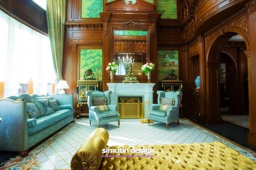 This living room uses a combination of blue, yellow and green on a backdrop of ornate natural wood walls to create an elegant and lavish look.