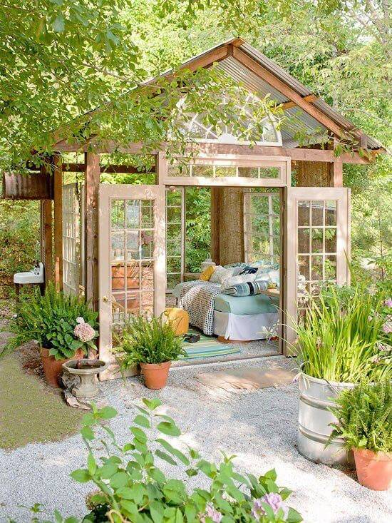 Bright and serene, french doors act as both walls and windows for this picturesque backyard escape.