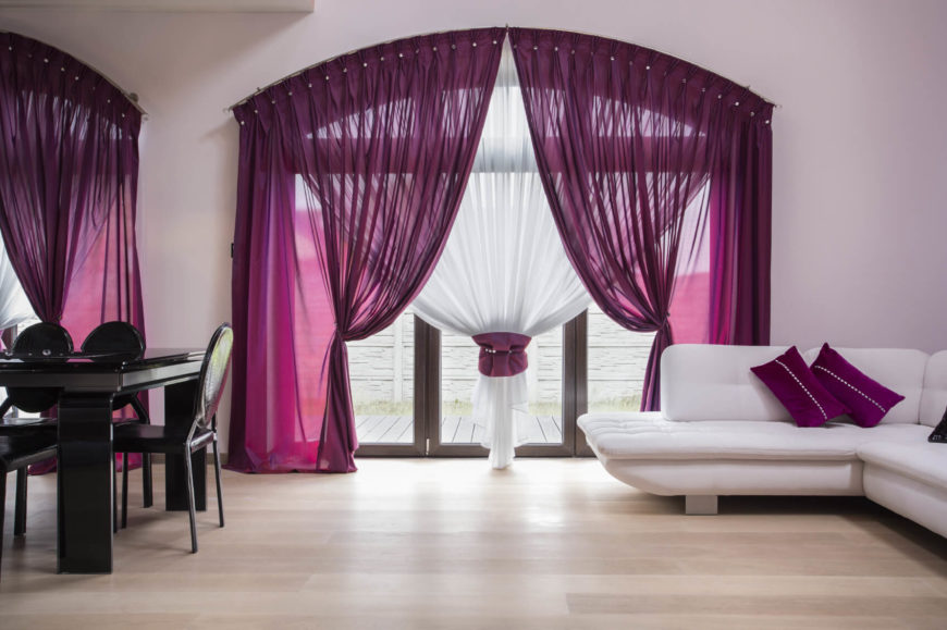 This room is a super simple and pretty color design. The rich purples along with the monochrome of the rest of the room makes a very planned and intentional look. It is very clean and makes an impact.