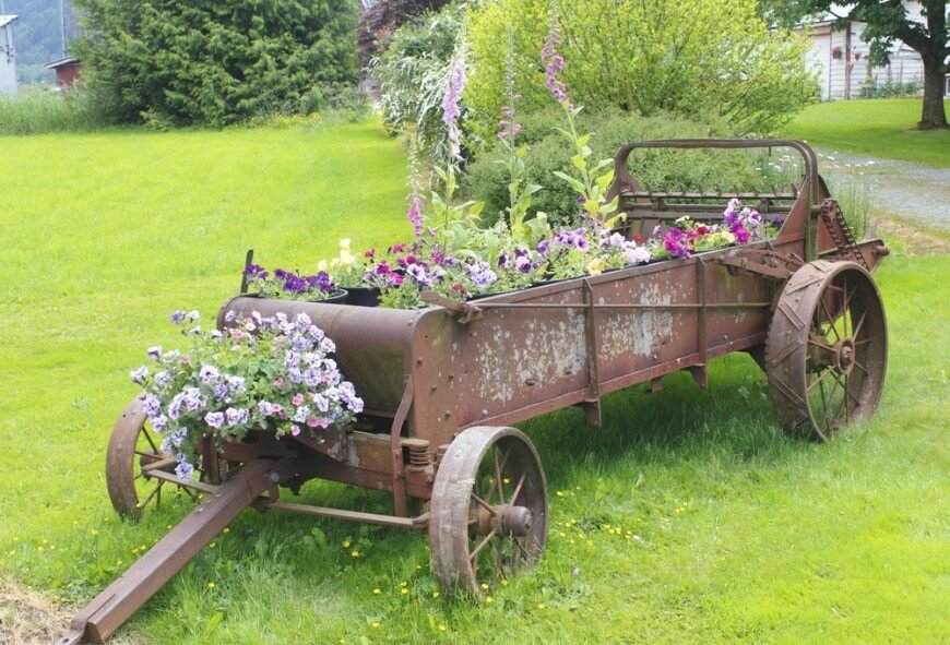 This antique, rusted wagon is filled with a large varieties of flowers, including a few taller varieties to give the display height.