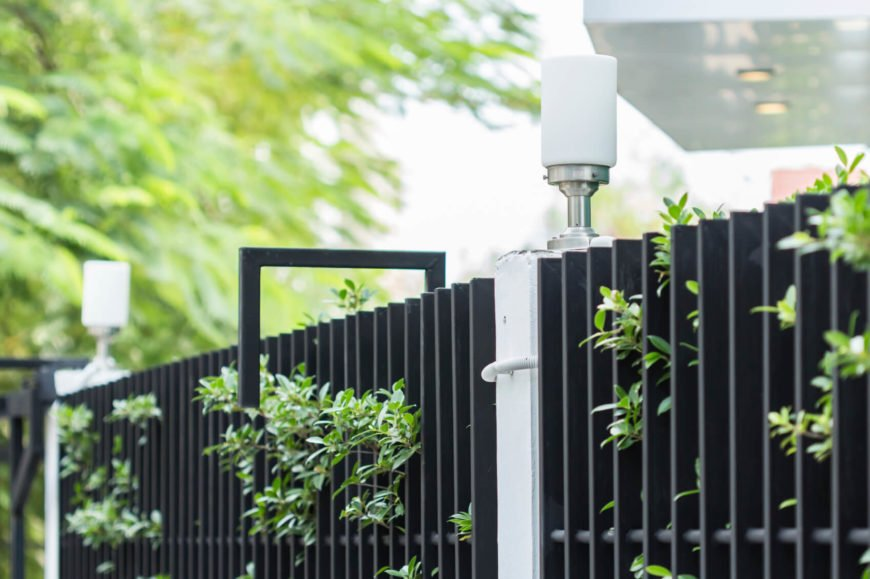 A simple white light element posts this iron bar fence design.