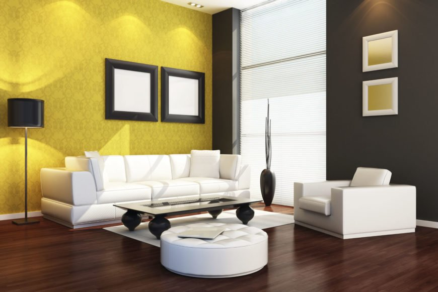 Stark white furnishings are backed by black and yellow walls. This is a bold and interesting color scheme that has a great deal of visual appeal.