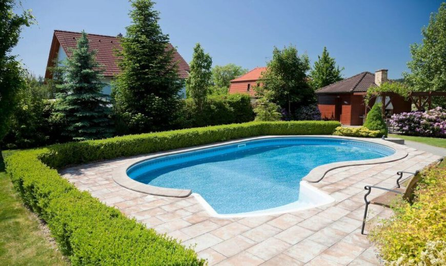 This pool is a slight kidney shape pool in a nice brick patio area.