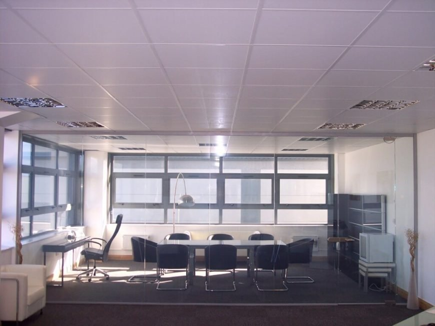 Here's the same room as seen above. With the power applied, the glass turns completely transparent, revealing a conference room. For home or office applications, this instant privacy access is invaluable.