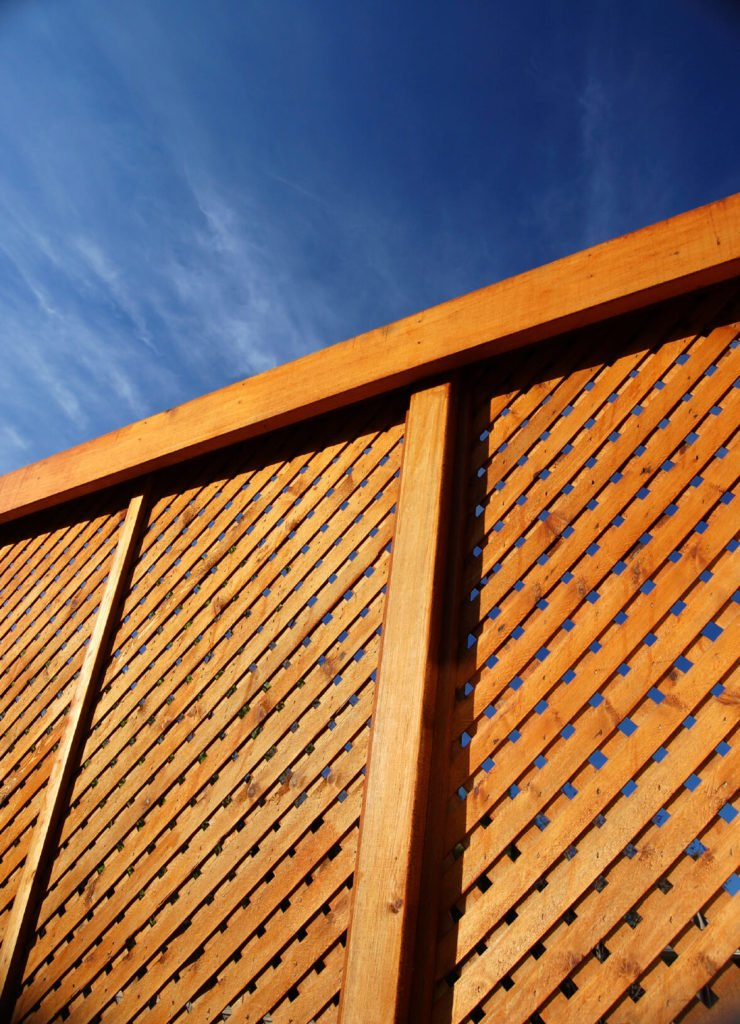 This tight weaved wooden lattice functions as a privacy fence with a cool design.