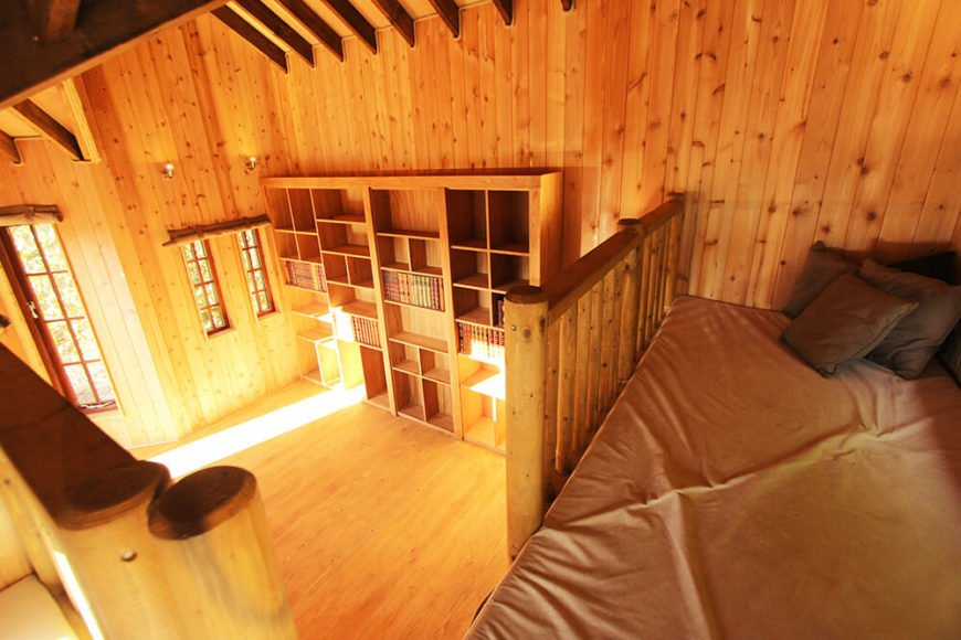 The bookshelf stands out as a particularly detailed component of the treehouse.