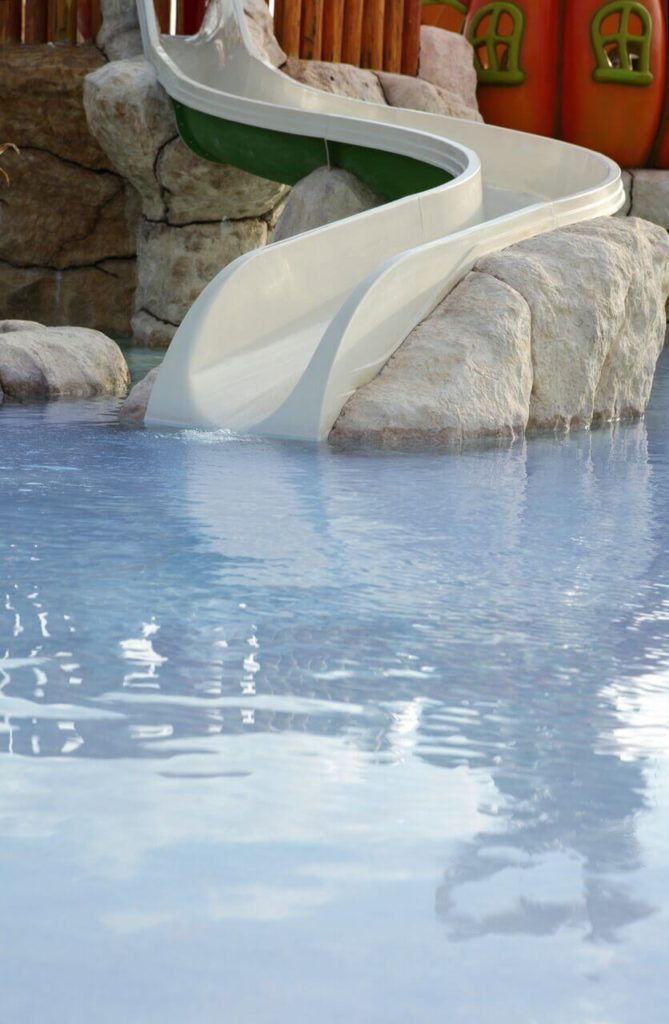 This pool slide is built into a rock structure, starting at a fun play place for kids. This is the perfect fun slide for kids.