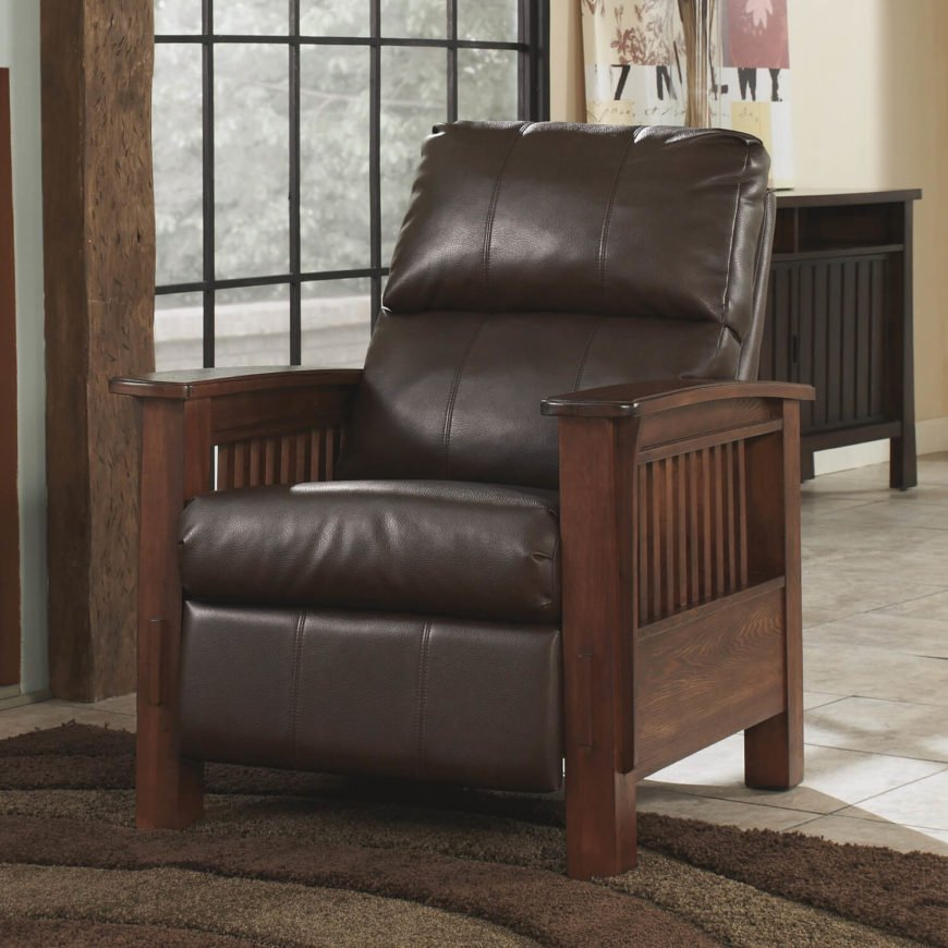 You'll notice that the dark wood framing of this chair features a similar design to the previous chair, arranging a series of vertical slats between thick layers of natural wood. Free of embellishments, the sleek styling complements the rich leather upholstery well. Here, the wood acts as a warm contrast to the dark leather tone.