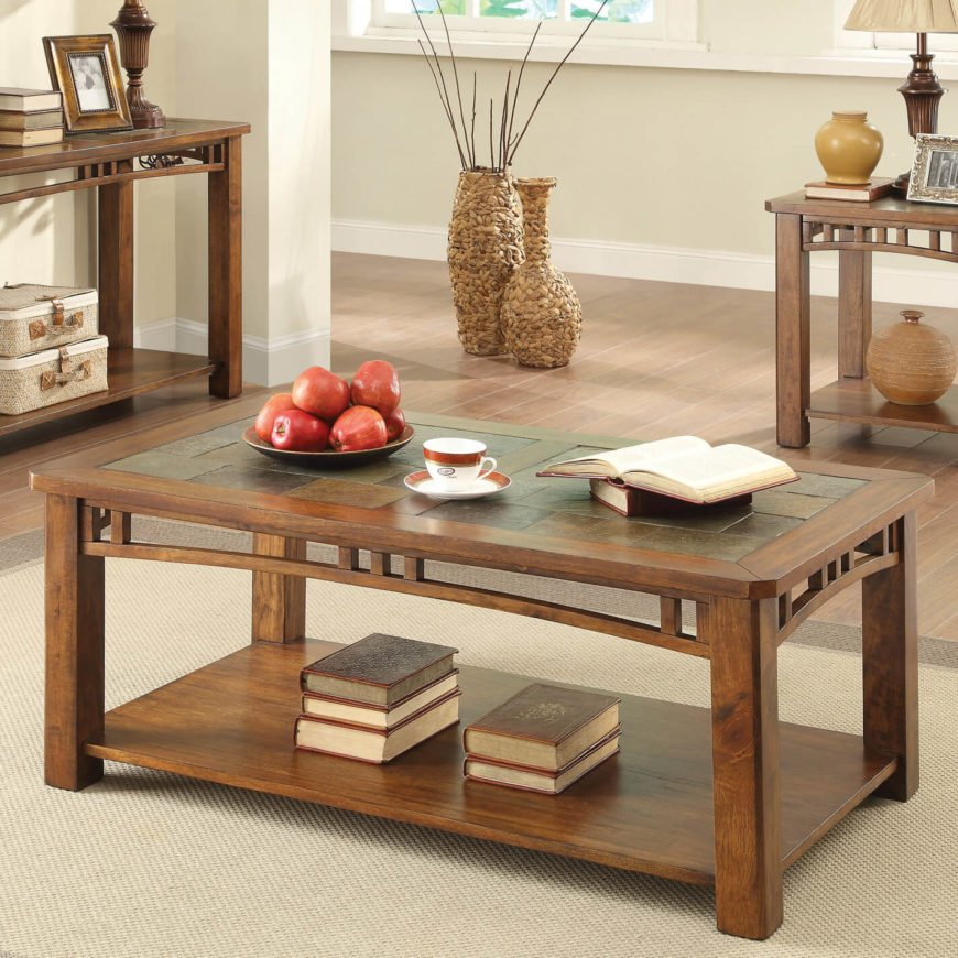 Here's another elegant, rich wood coffee table with a subtle but gorgeous accent in the tabletop. Here we see slate tiles encompassing most of the surface area, framed in thick wood beams all around. The table features a bit of ornamentation around the edges, strung between the legs, but it's unfussy and sleek, remaining true to the style.