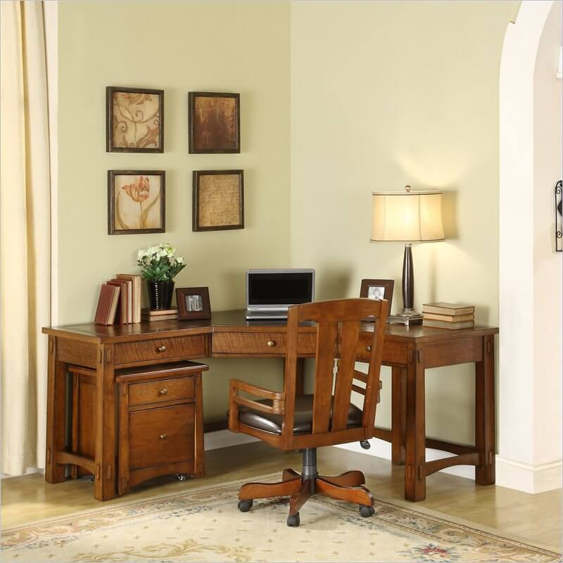 Unlike the previous two Craftsman desks we've featured, this model is a little more elaborate, perhaps meant to dominate a smaller home office space than take up the corner of your large open living room. Still, given a properly sized room, this can make for the perfect addition, with its rich all-wood construction and relatively sleek design. The corner shaped desk features an accompanying dresser-like component on casters for easy access.
