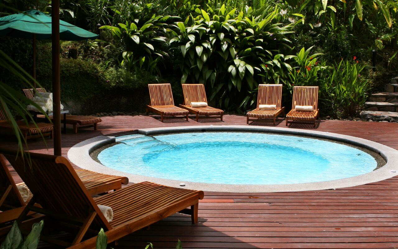 A nice round plunge pool surrounded my seating. the size and shape of this plunge pool allows for a number of people to soak and cool off all at once.