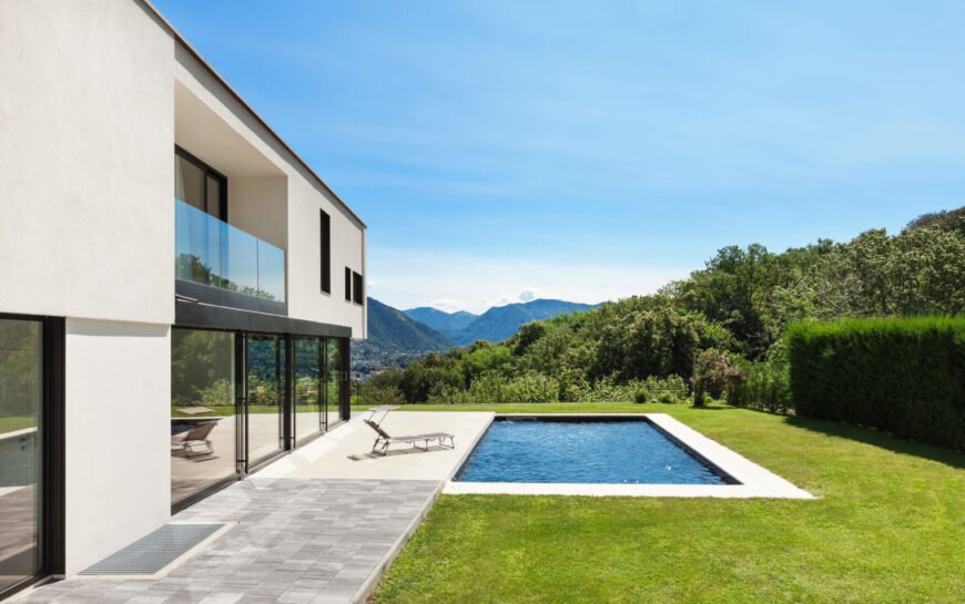 A very simple pool behind this villa style home. The room exists for a larger full size pool, but by sizing down the space the pool takes up, there is room for both a pool and a well manicured lawn.