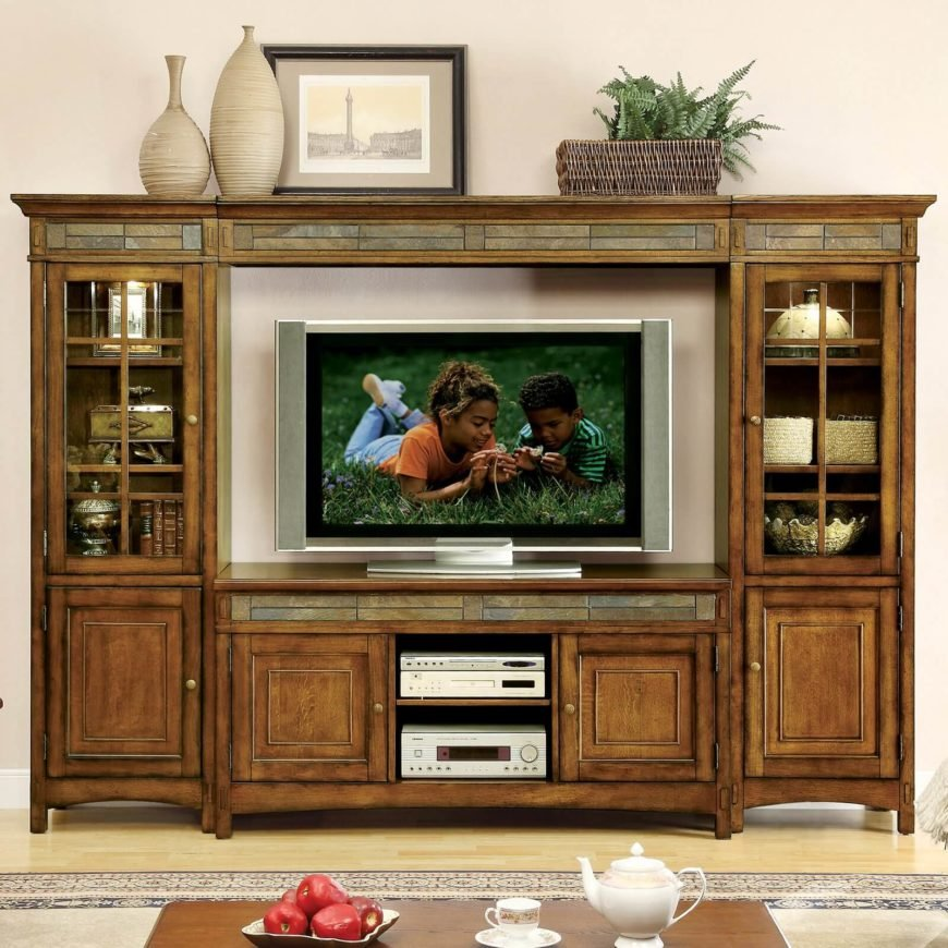 For our first piece of craftsman styled furniture, we wanted to showcase something big and bold. This large entertainment center features a center console for the TV itself, flanked by a pair of tall glass-enclosed shelves, with a bridge over the top connecting the pieces. In addition to the sharply defined natural wood construction, it features slim accent pieces above and below the TV gap, plus built-in lighting in the cabinetry.
