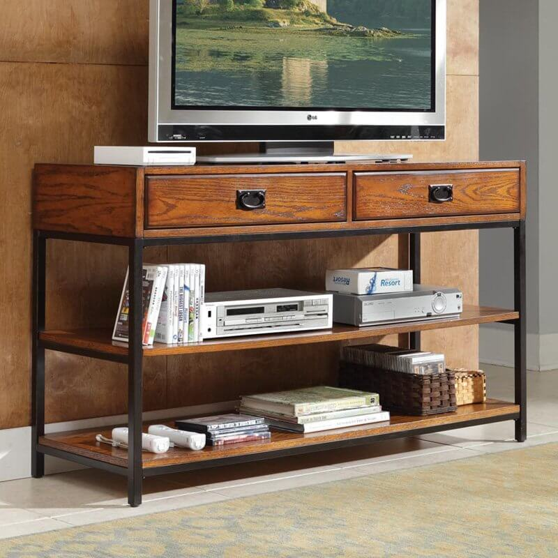 This console style piece features our first instance of metal, pairing perfectly with the rich wood tones of the stand. This design sees a thick tabletop with large drawers framed with a pair of lower shelves by a thin black metal structure, plus matching drawer handles for an extra dose of contrast.