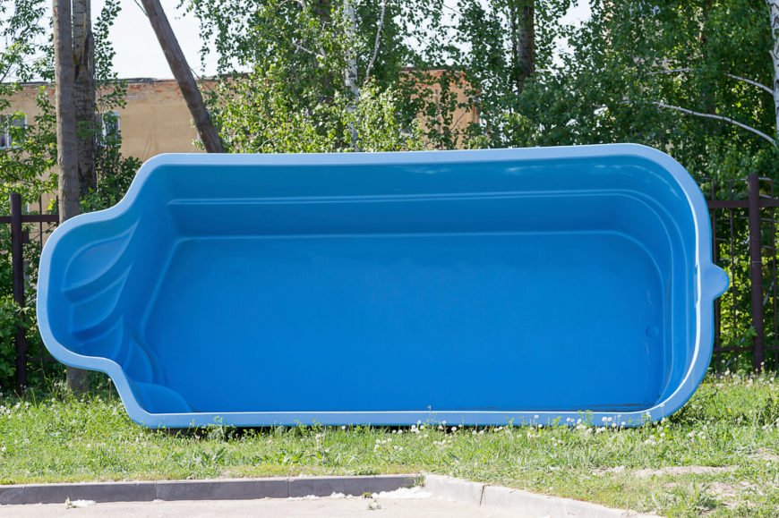 The blue plastic swimming pool on the side of the form