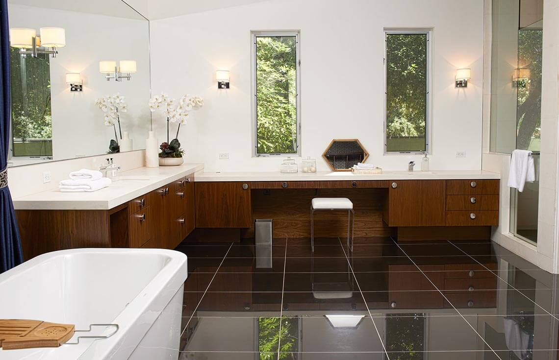 Here is a lovely example of a staged bathroom. The clean counters and the white linens give this bathroom a luxury feel. The folded stacks of towels give this bathroom a spa feel, which just adds to the luxury feel. The bright lighting also makes this space feel large and welcoming. The counters are free from all personal effects, and only adorned with a few decorative items that add to the elegance of the room.