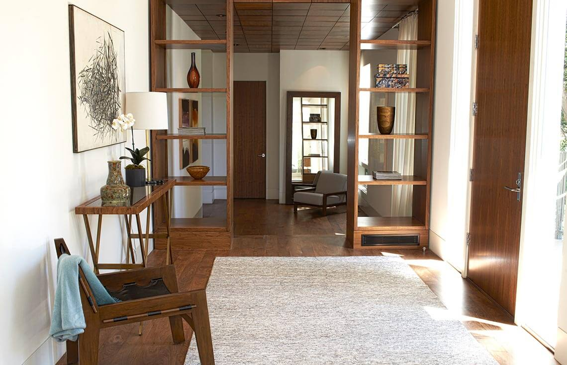 This brightly lit foyer shows a very open and welcoming entrance. The flow in this foyer invites people coming through to enter into the rest of the house. This room sets the tone for the visit as a bright and warm experience.