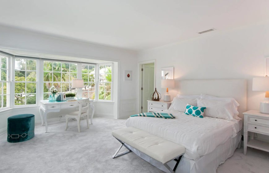 While in most bedrooms, the bed is a focal point, this bedroom chooses to allow the magnificent view from the bay windows take center stage, and the bed plays second fiddle, blending into the light color palette.