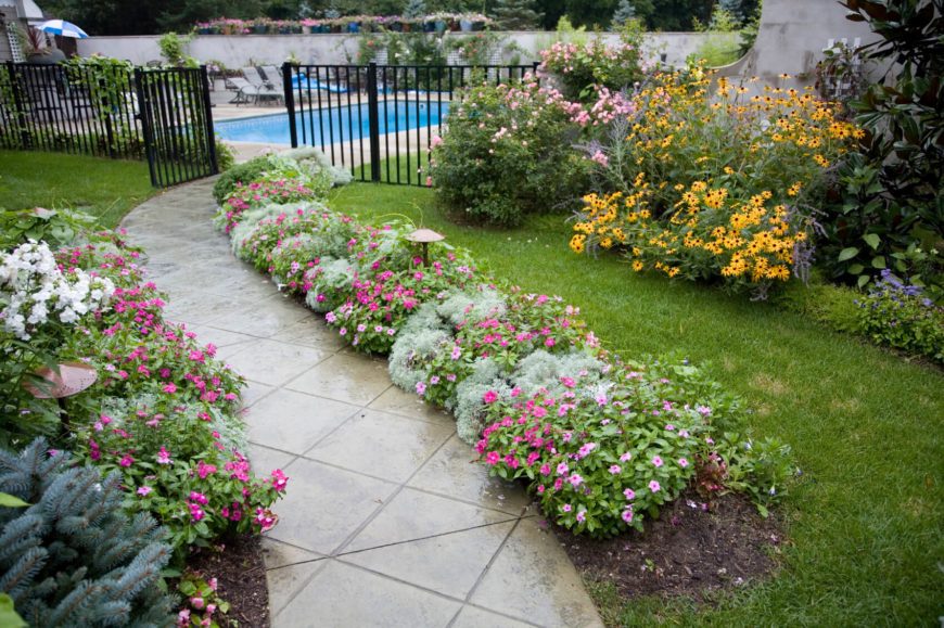 Along the sides of a walkway is a great place for a line of flowers. A walkway lined in flowers has an elegant and fancy feel that highlights the path. Anyone walking down this path is sure to feel like royalty.