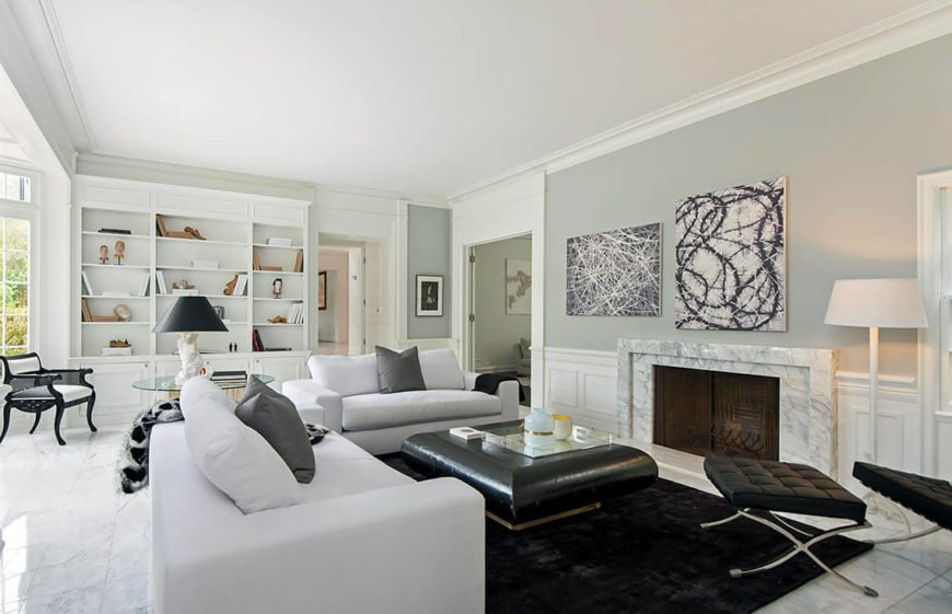 This living room has a great sense of symmetry and is well lit. The built in bookcases are displayed very well thought small groupings of items. Not too much as to look cluttered, and no single item distracting from the features. The bookcase is feature that buyers love, and the clever staging of it makes it even more interesting for those walking through.