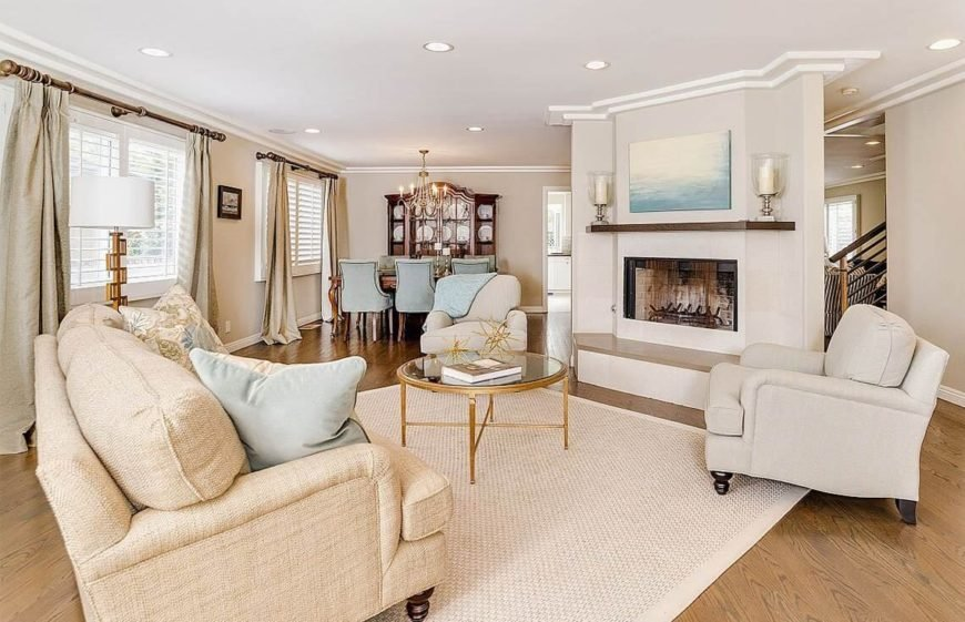 This living room has amazing symmetry. The chairs on either side of the fireplace, facing the sofa, create an attractive conservation area for the potential buyers to picture themselves and loved ones occupying.