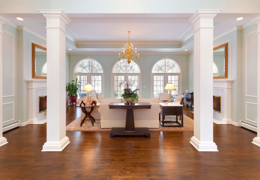 Here is a classic example of a tray ceiling. This option can make a room feel very classy, especially when paired with such elegant and interesting light fixtures.