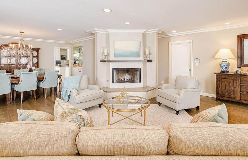Another angle on the same living room where the symmetry is even more apparent. Here we can also see the brightness of the room, and how the hardwood, the beige, pale blues and golds make this room shine.