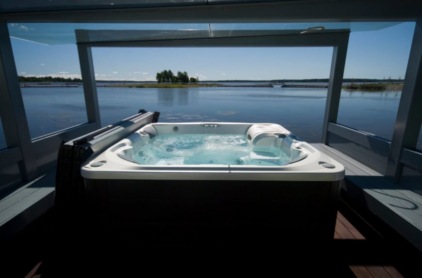 It's easy to unwind and let the world slip away when you are taking it easy in this hot tub, overlooking the water and the endless sky. There is nothing better after a stressful day then letting this kind of hot tub take your cares away.