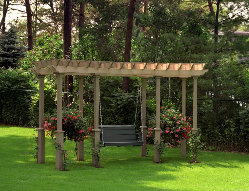 This swing is hung by chains from an overhang that also holds two large hanging planters. Hanging flower planters adds some visual appeal to your swing, making it even more relaxing and inviting.