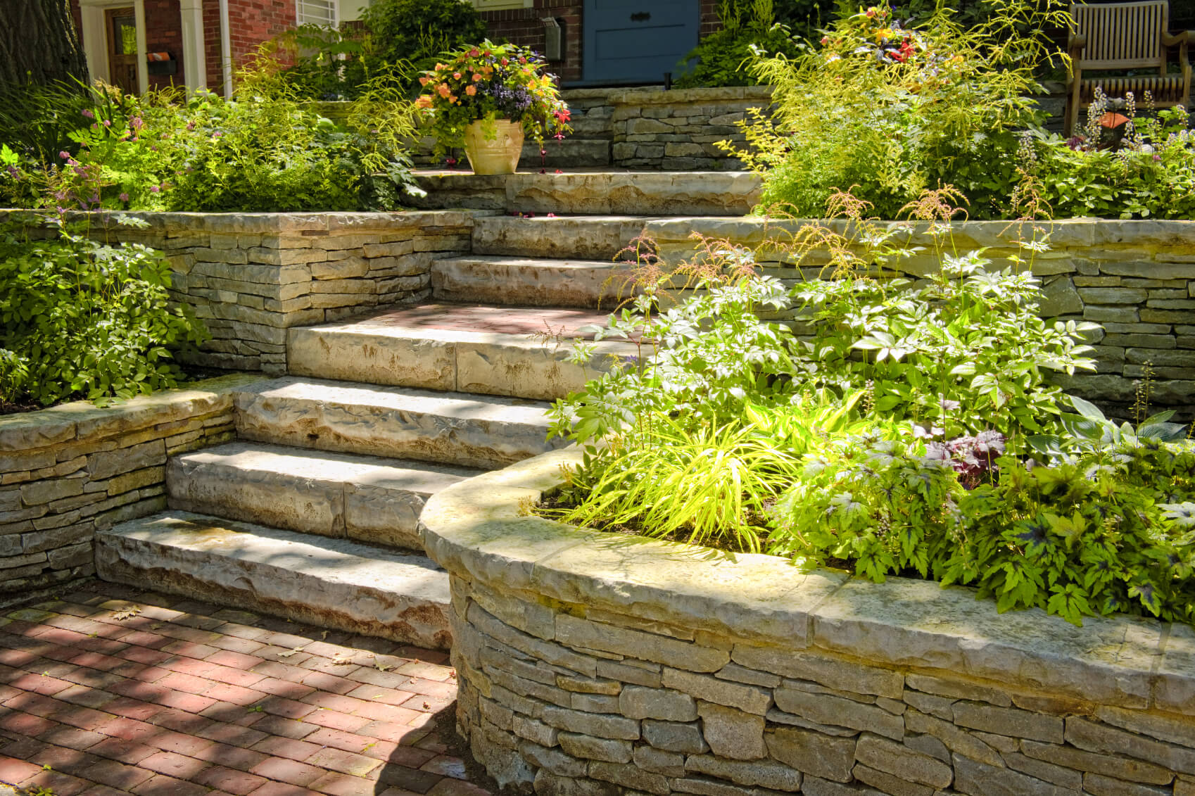 If you have a stairway to your front door, a flowerbed may be great on either side of the steps. Adorning your entrance with vibrant colors makes your home a very welcoming place.