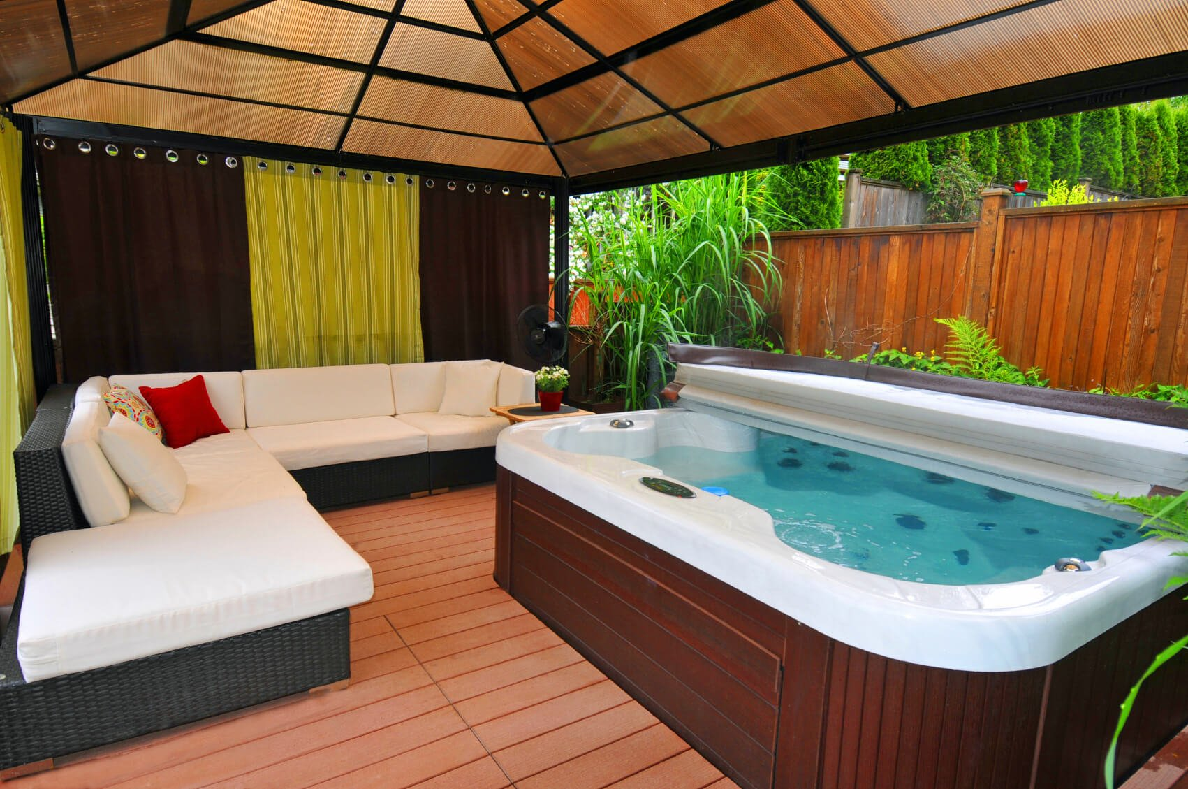 This area can be private and secluded or open wide to the worlds, but there is always ample room for people to sit in and out of the hot tub.