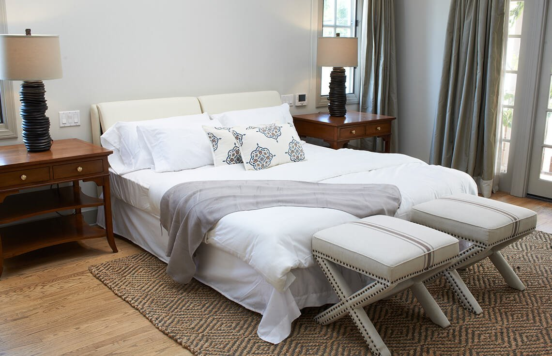 Again, we see benches and patterns used to draw the eye to the bed as a focal point. Decorative lamps add an interesting element.