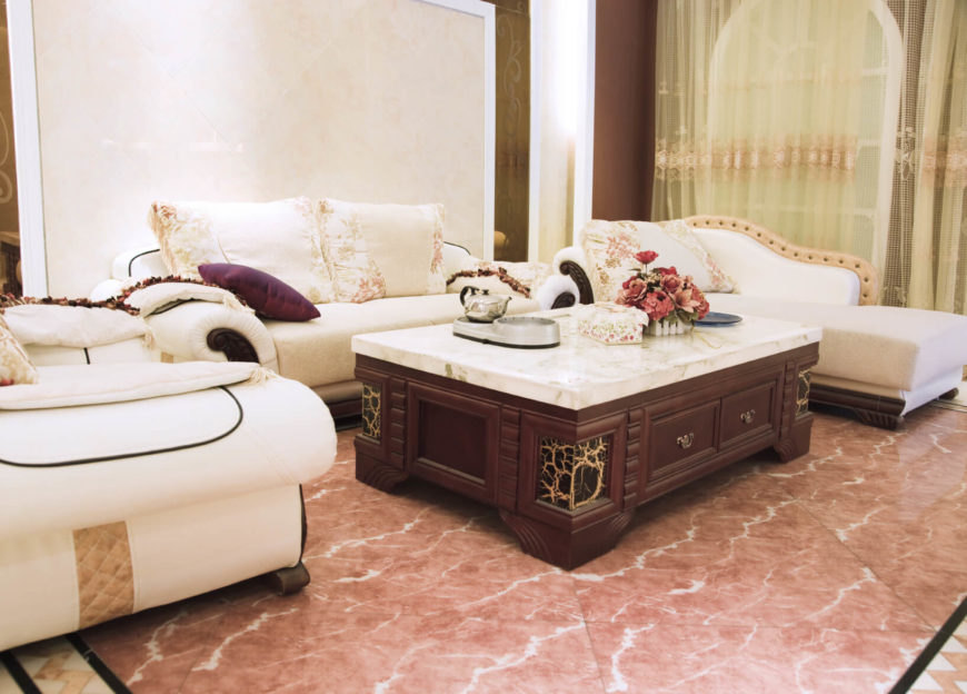 This stunning coffee table is topped with marble. There are drawers on the side of the table which provide the room with a bit of extra storage. This is a great table with a design feature that really adds a lot to the room in general.