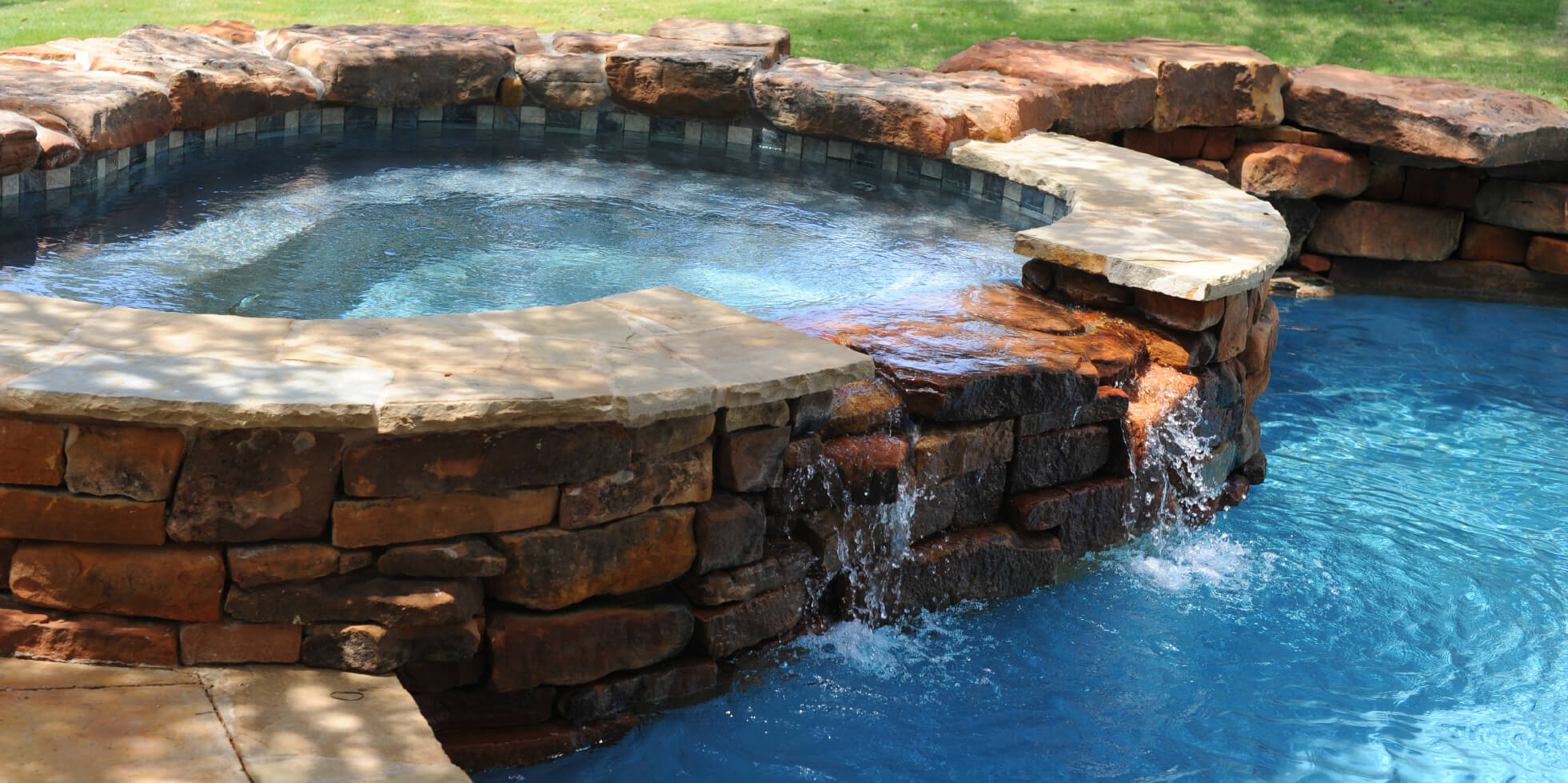 By lining your hot tub in stone or brick you can really incorporate it into the rest of your landscaping and yard features. Tying them to other features in the yard may prevent them from feeling like a standalone piece.