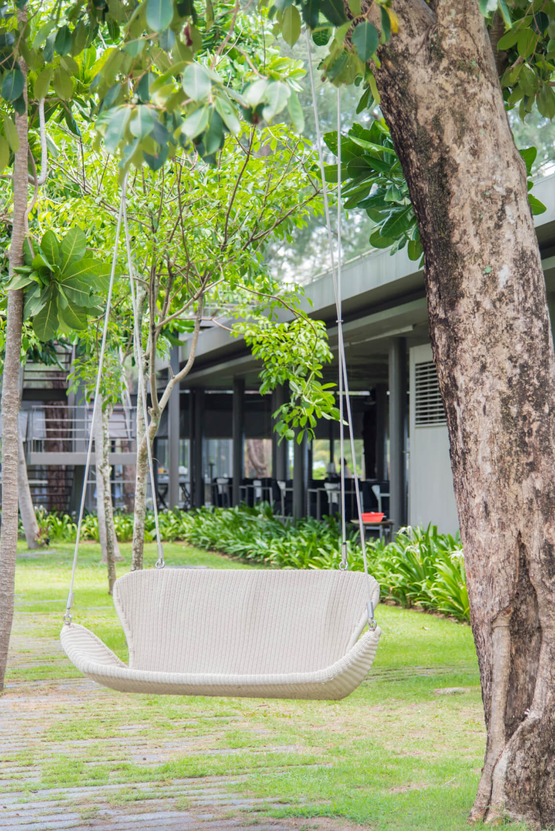 Here is an interesting yard swing with a simple and minimal design. The simple and bright color of this seat works well with any design, and would look great in any garden.