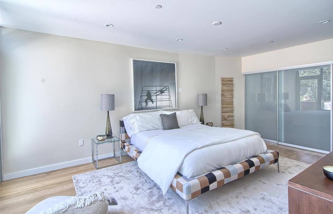 The checkered pattern on the bed frame is a great example of using color and pattern in a more subtle way to draw attention to the bed as a focal point.