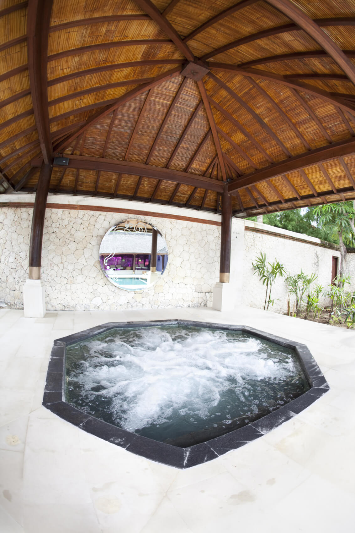 Not all hot tubs are the same shape. While many are rectangular or circular, you can get custom tubs in a great variety of shapes. Here is a luxury hot tub in an octagonal shape.