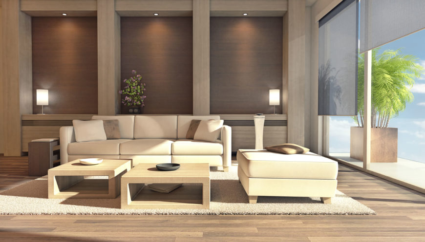 This living room has two coffee tables with a natural wood tone finish. This pairs nicely with the light, bright colors of the sofa and carpet. The ample natural light coming in through the window and shining on these colors really brightens the room up.
