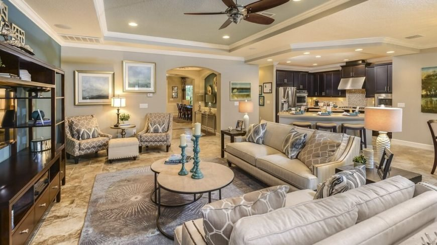 Here is a bright living room with a simple version of the tray ceiling. The tray ceiling shows that it can fit with a great deal of styles, even if does not have fancy adornments or intricate design elements. Simple works well with everything.