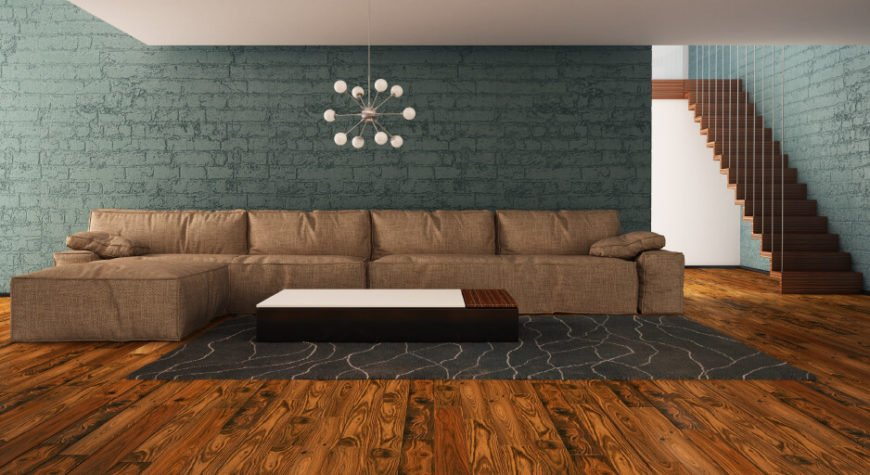 Here is a living room with painted brick. Brick can be painted to match a color palette or to change the feel of a room. Because of the textures involved in the bricks, the paint wont be even, so the color will still have a dynamic and interesting look.