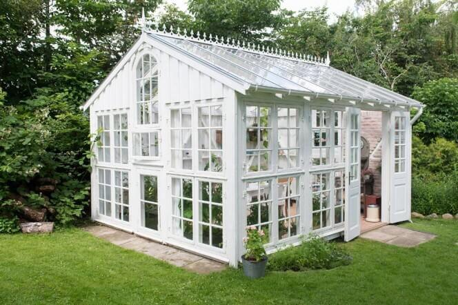 Here we see an ornate and decorative take on the greenhouse. There is no need for a greenhouse to fit into a mold. This greenhouse shows us that you can also add some personal touches to your utility buildings.