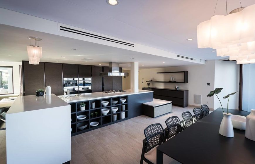 Modern kitchen with plenty of open shelving and a unique countertop layout.