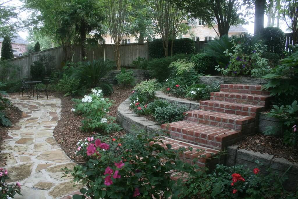 Using multiple levels can add some interesting dynamics to your flower garden. Lining your garden with bricks and stone gives the flower bed a finished and rugged look. Bricks lean a bit more industrial, while stones are more rustic.