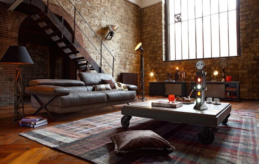 Here is a warm and cozy living room surrounded by amazing exposed brick. The exposed brick is a classic and timeless look that has an industrial appeal.
